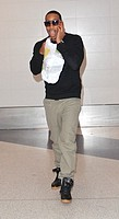 Celebrities at LAX airport in Los Angeles Featuring: Ludacris,Christopher Brian Bridges Where: Hollywood, California, United States When: 31 Oct 2014 ...