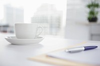 Coffee cup and saucer on desk