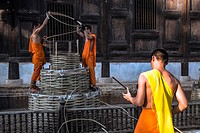 Asia. Thailand, Chiang Mai. Wat Phantao. Novice monk working on the renovation of the temple.
