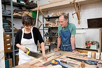 Carpenter and female apprentice at work