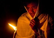 Orthodox Pilgrims At Timkat Festival During Nightime, Lalibela, Ethiopia.