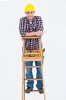 Repairman holding spanner while climbing ladder