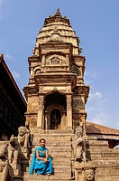 Young Woman Sitting on Stairs of Siddhi Laxmi Temple in Durbar Square, Bhaktapur, Bagmati Zone, Nepal.