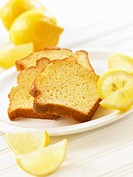 Three slice of lemon cake and fresh lemons