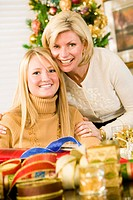 Mother and Daughter Wrapping Christmas Presents