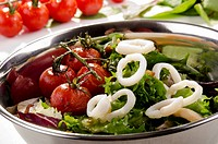 grilled squid rings, tomato and fresh salad