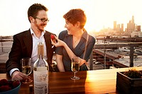 USA, California, Los Angeles, Couple drinking wine on porch at sunset