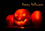 Halloween background with glowing jack-o-lantern in the darkness