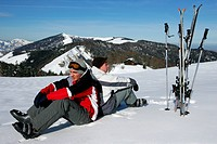 Skiers sitting in the snow