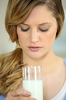 pretty young blonde with glass of milk