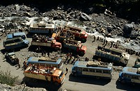 Road block on road to La Paz with view over buses, trucks and passengers at a standstill in road