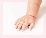Closeup of baby hand isolated on white background, healthcare, children hospital, protect and help concept