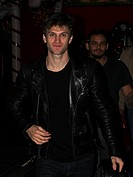 Actor Keegan Allen goes shopping at The Grove, carrying a motorcycle helmet and wearing a Louis Vuitton backpack and black leather jacket. Featuring: ...