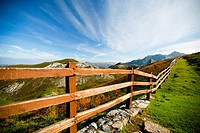 Spain, Picos de Europa National Park, Lakes of Covadonga, Scenic view of wooden fence on hill