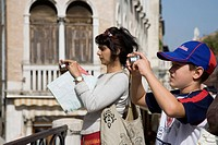 Mother and son take photographs of canal view opposite St. Marks.