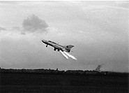 Start a MiG-21SPS with the tactical identifier 730 of the GDR Air Force - Air defense missile fired auxiliary starter on the grass runway of the airpo...