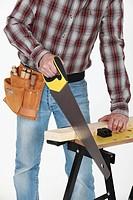 closeup on tradesman handling saw