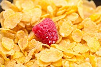 raspberry,milk and flakes in a bowl
