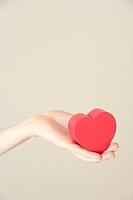 Heart shaped toy in hand