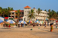Tourists spending an evening time at Kovalam beach, Thiruvananthapuram. Kovalam is a beach town by the Arabian Sea in Thiruvananthapuram city, Kerala,...