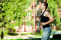 Young man jogging in park. Health and fitness.