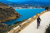 View of a cyclist in Albir area, Alicante province, Spain.