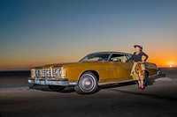 Portrait of senior woman standing beside yellow car