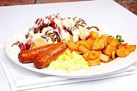 Eggs sausage potatos and waffle with fruit