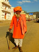 Indian man walking in the street of Pushkar, Rajas