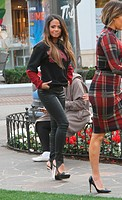 Christina Milian conducting an interview at The Grove in Hollywood wearing sky high heels Featuring: Christina Milian Where: Los Angeles, California, ...