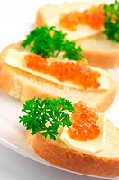 Canapes with salmon caviar