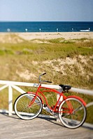 Red beach cruiser bicycle.