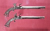 Pair of flintlock pistols, c.1730-40 / Glasgow Art Gallery and Museum, Scotland / Bridgeman Images