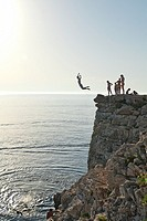 Locals jump from a cliff in Verudela, nearby Pula.