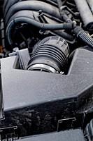 A black interesting car engine close up