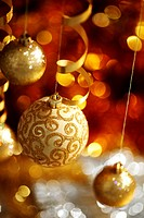 golden christmas balls on bokeh background