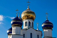 Sparkling domes of orthodox church against the blue sky in the winter