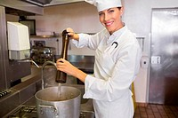 Smiling female cook preparing food