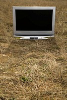 Television in grass.