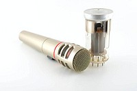 Old glass triode (valve) and microphone over white