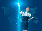 Attractive blonde touching the button in virtual future interface