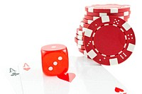 poker chips, cards and red dice cube