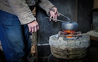 Takahiro Koizumi is putting the finishing touches at iron teapot or tetsubin, nanbu tekki,Workshop of Koizumi family,craftsmen since 1659, Morioka, Iw...