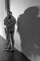Insane man in the hallway wearing a straitjacket