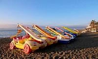 Paddle Boat on the beach. Costa del Sol (Coast of the Sun), Malaga in Andalusia, Spain
