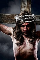 Jesus Christ with crown of thorns white on the cross of Calvary representation
