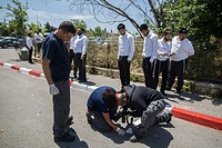 (150504) -- JERUSALEM, May 4, 2015 () -- Israeli forensic policemen inspect the site of an attempted stabbing in Jerusalem, on May 4, 2015. Israeli se...