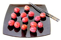 plums and Chinese sticks