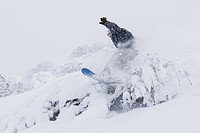 Male snowboarding near Homer, Kenai Peninsula, Alaska, winter