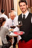 Waiter hold wine glasses business lunch restaurant